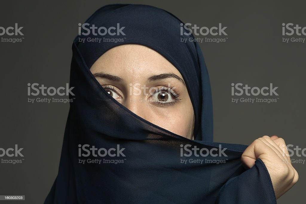 Woman with religious veil, looking surprised royalty-free stock photo