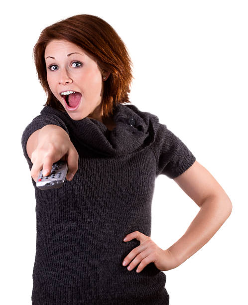 Woman with remote stock photo
