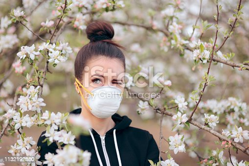 istock Woman with Respirator Mask Fighting Spring Allergies 1132192880