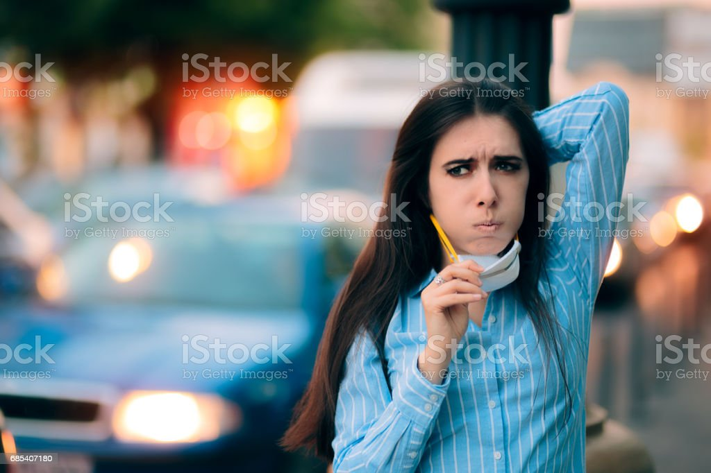 Woman With Respiratory Mask Out in Polluted City stock photo