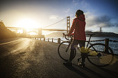 Commuter with road racing bicycle and Golden Gate Bridge