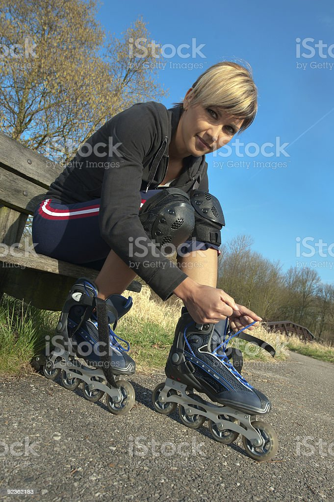 Woman with Rollerblades royalty-free stock photo