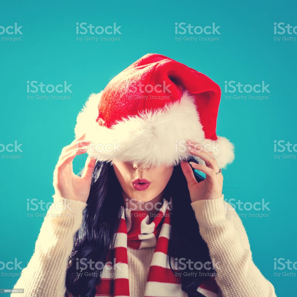Woman With Santa Hat Pulled Over Her Eyes Stock Photo & More