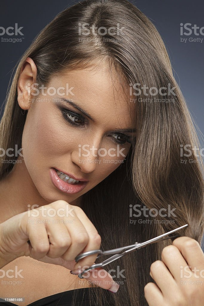 Woman with scissors royalty-free stock photo