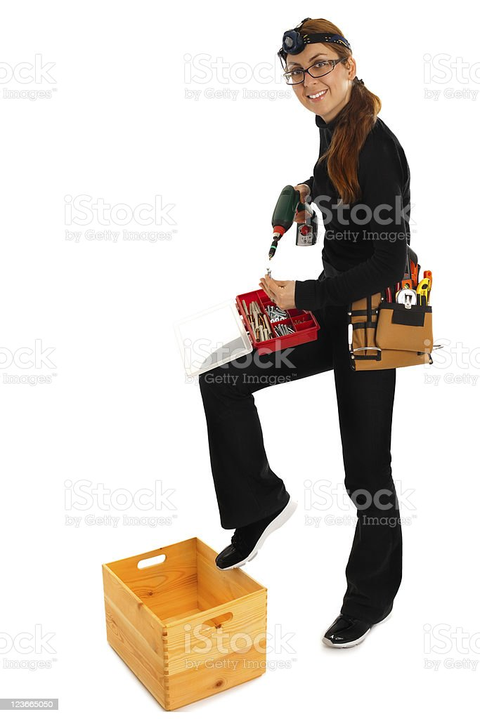 Woman With ScrewDriver stock photo