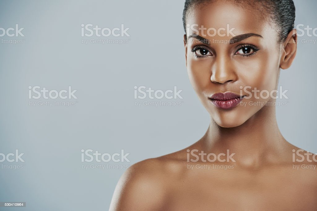 Woman with seductive expression on gray background stock photo