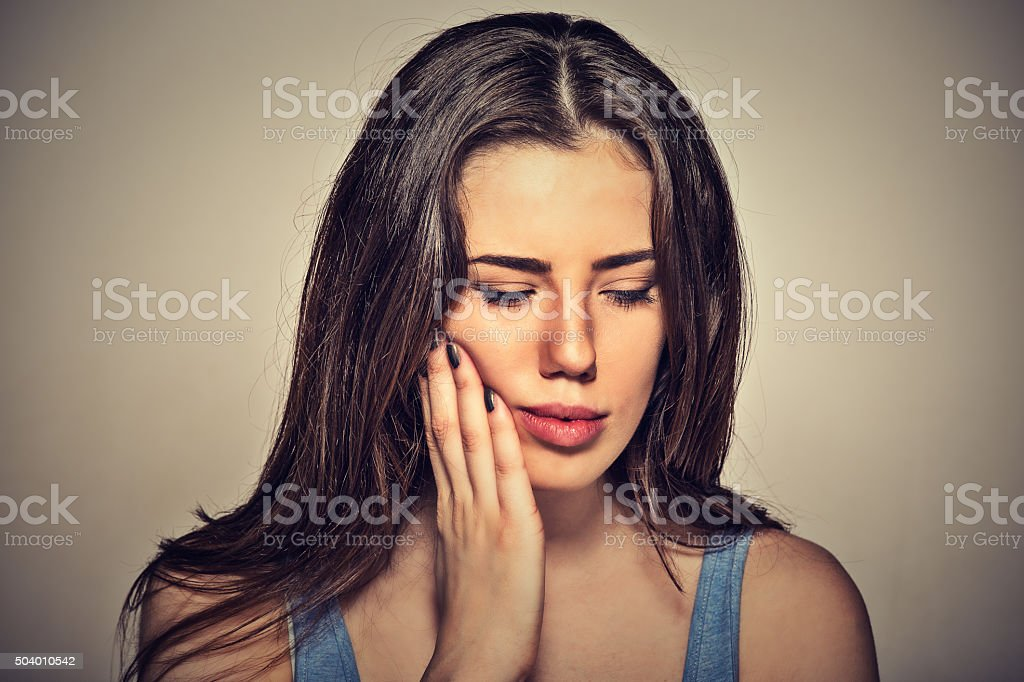 woman with sensitive toothache about to cry from pain stock photo