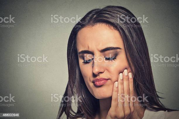 Woman With Sensitive Toothache Crown Problem Stock Photo - Download Image Now