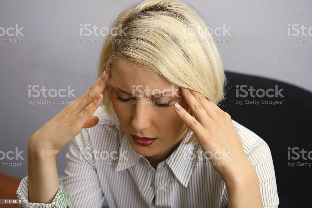 Woman with severe Headache (Migraine). stock photo