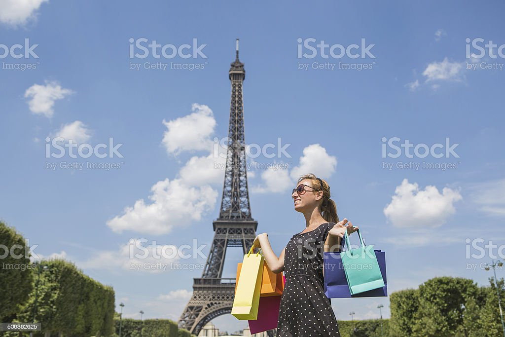 Woman with shopping bags at Eiffel tower royalty-free stock photo