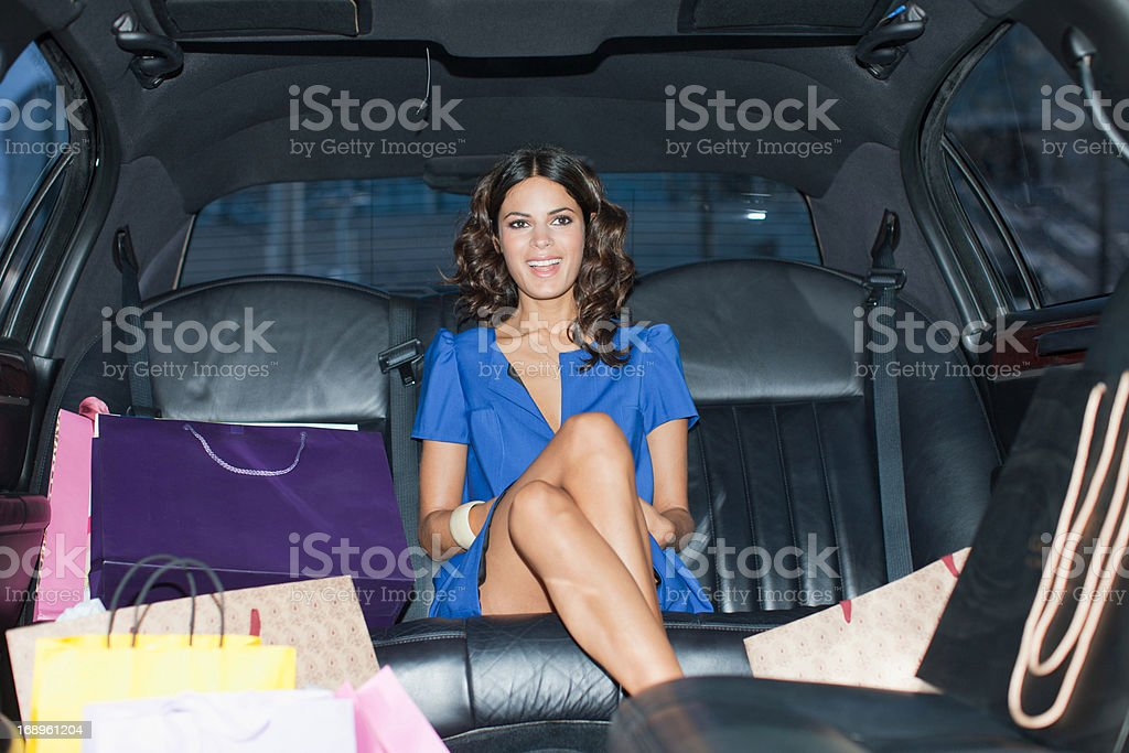 Woman with shopping bags in limo royalty-free stock photo