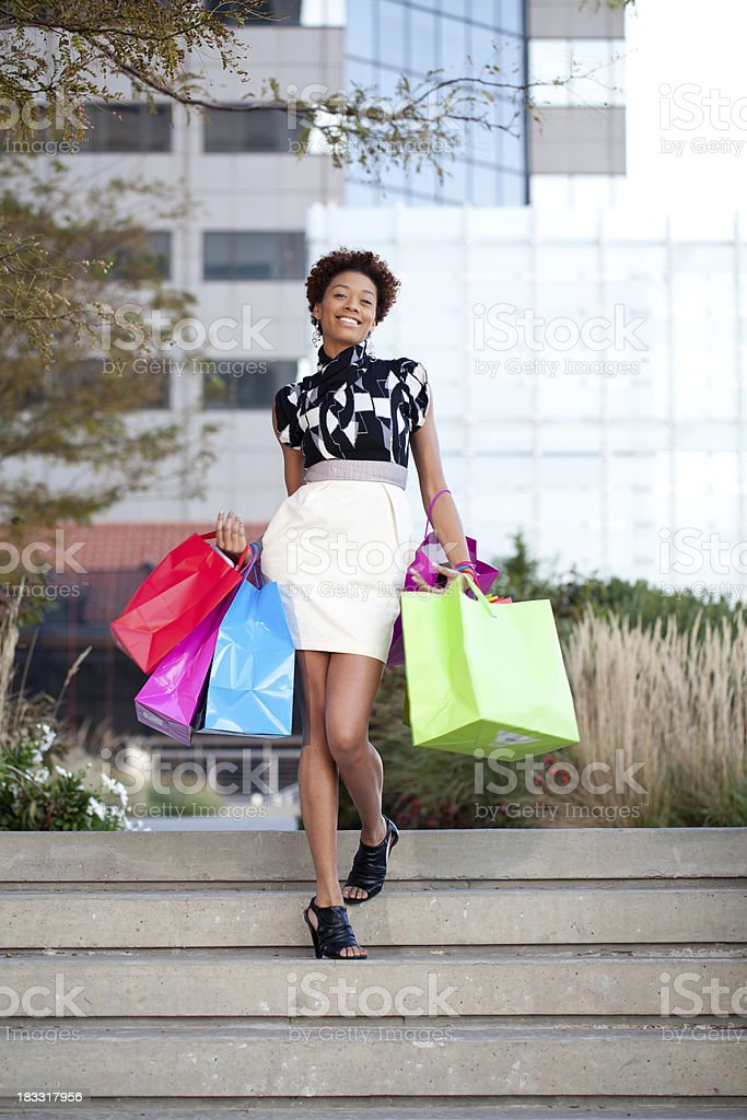 Woman with shopping bags outdoors royalty-free stock photo