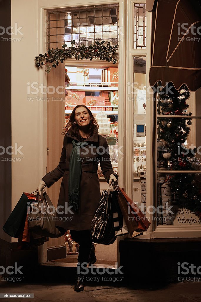 Woman with shopping bags, smiling 免版稅 stock photo