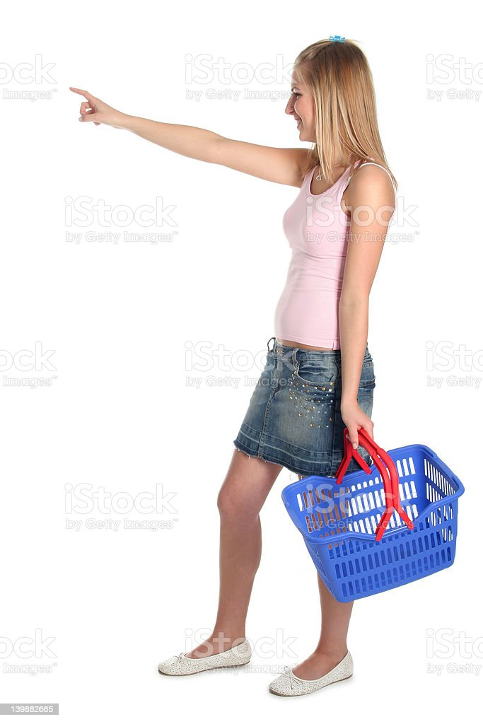 Woman with shopping basket, pointing royalty-free stock photo