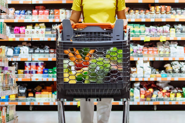woman with shopping between store shelf copy space stock photo