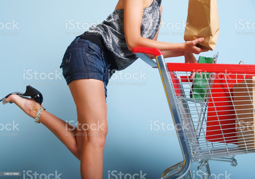 Woman with Shopping Cart royalty-free stock photo