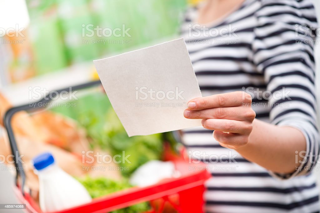 Woman with shopping list stock photo
