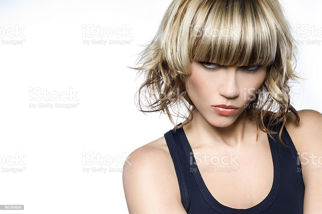 Woman with short blond hair with a mean look on her face stock photo
