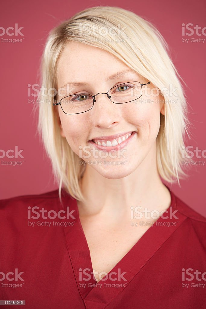 Woman with short blonde hair and glasses royalty-free stock photo
