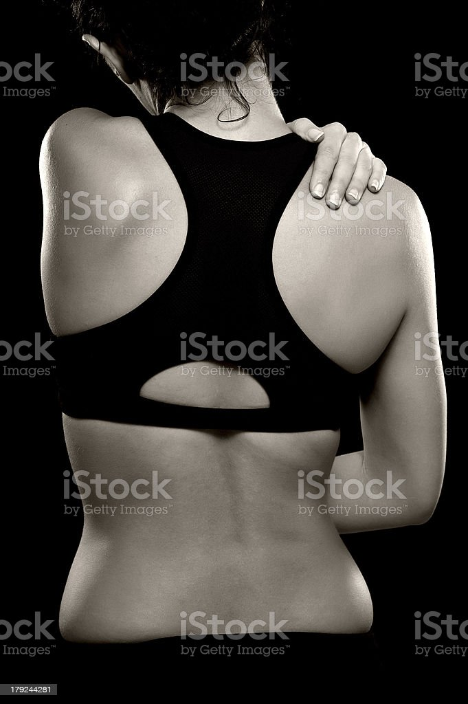 Woman with Shoulder and Back Pain royalty-free stock photo