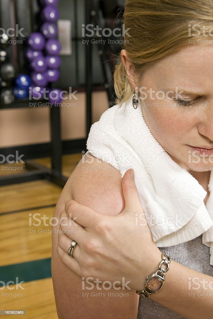 Woman with Shoulder Pain in a Gym  Adult Stock Photo