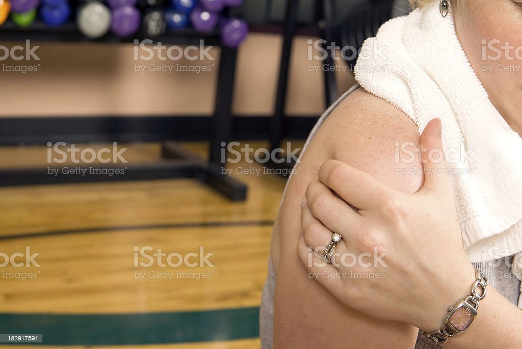 Woman with Shoulder Pain in a Gym royalty-free stock photo