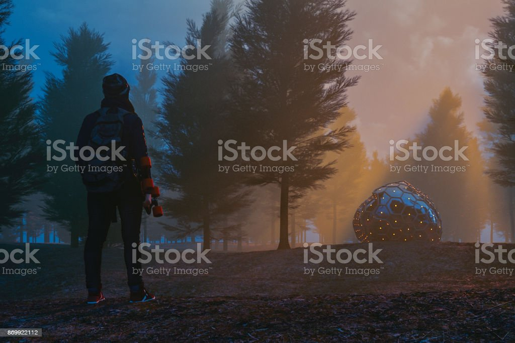 Woman with skate and mysterious alien object in the forest at night stock photo