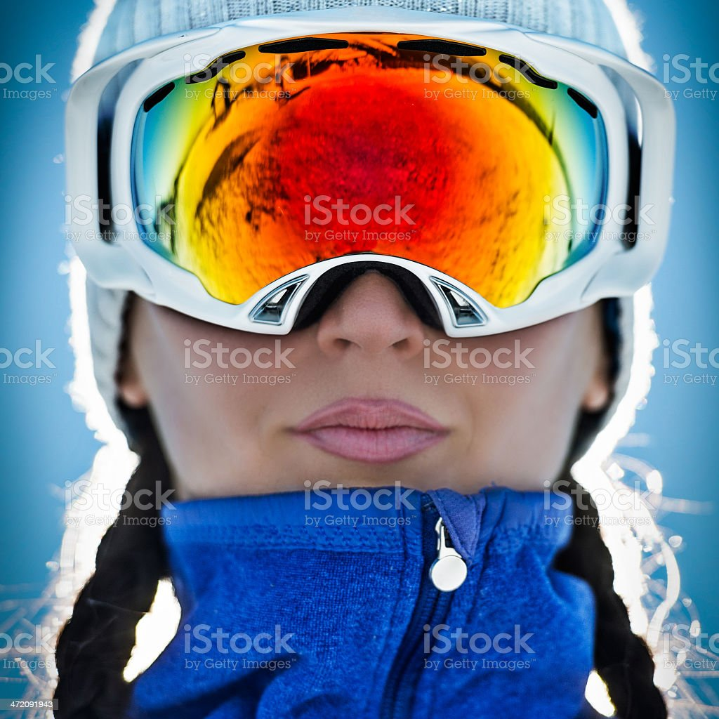Woman with ski goggles stock photo