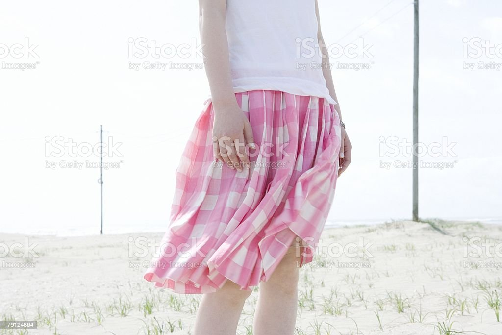 Woman with skirt blowing in breeze 免版稅 stock photo