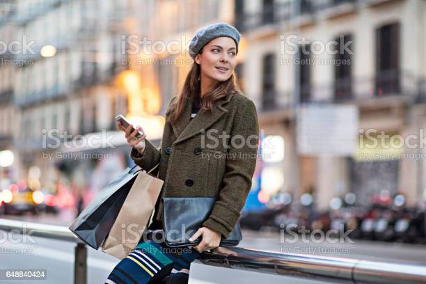 Woman with smart phone and shopping bags by street picture id648840424?b=1&k=6&m=648840424&s=612x612&h=xglev07c9o asleusoh98qpda0supxkuzownvrym2va=