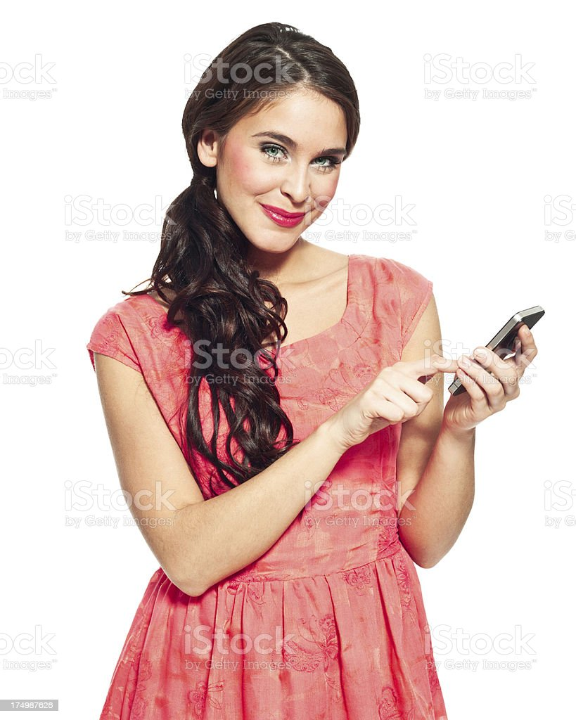 Woman with smart phone Portrait of beautiful young woman holding a smart phone and smiling at the camera. Isolated on white. 20-24 Years Stock Photo