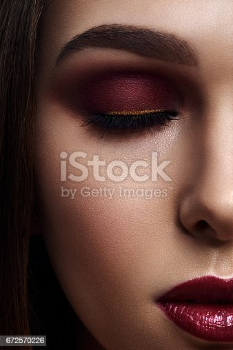 istock Woman with Smoky Eyes Make-Up and dark red Lips 672570226