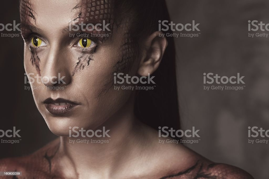 Woman with snake body-art stock photo