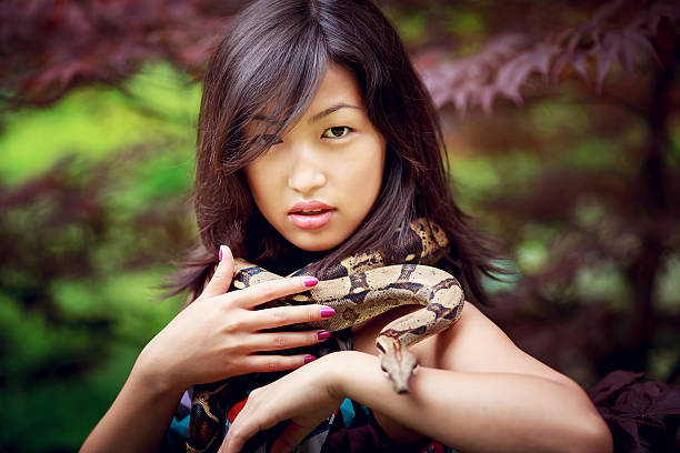 Best Sexy Girl With Snake Stock Photos, Pictures  Royalty-Free Images - Istock-2617
