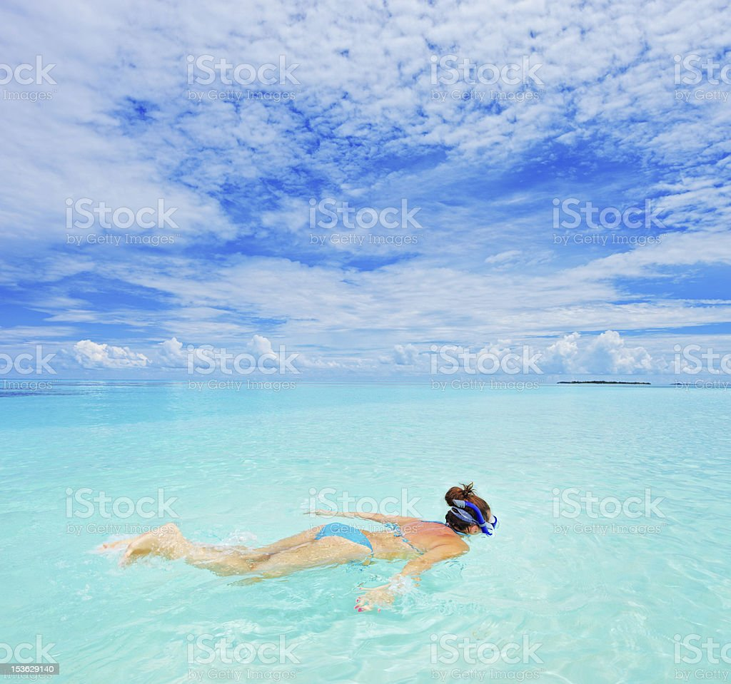 Woman with snorkeling mask diving royalty-free stock photo