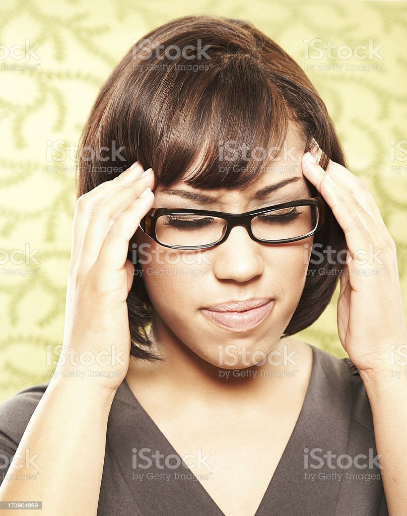 Woman With Spectacles and a Headache royalty-free stock photo