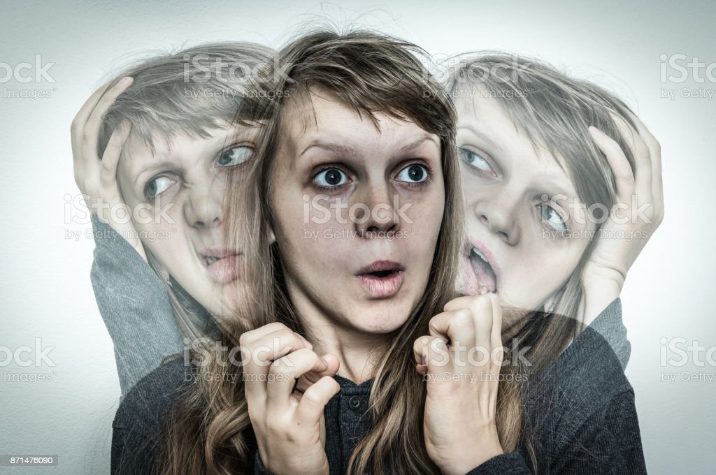 Woman with split personality suffers from schizophrenia stock photo