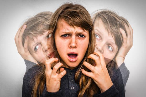 Woman with split personality suffers from schizophrenia stock photo