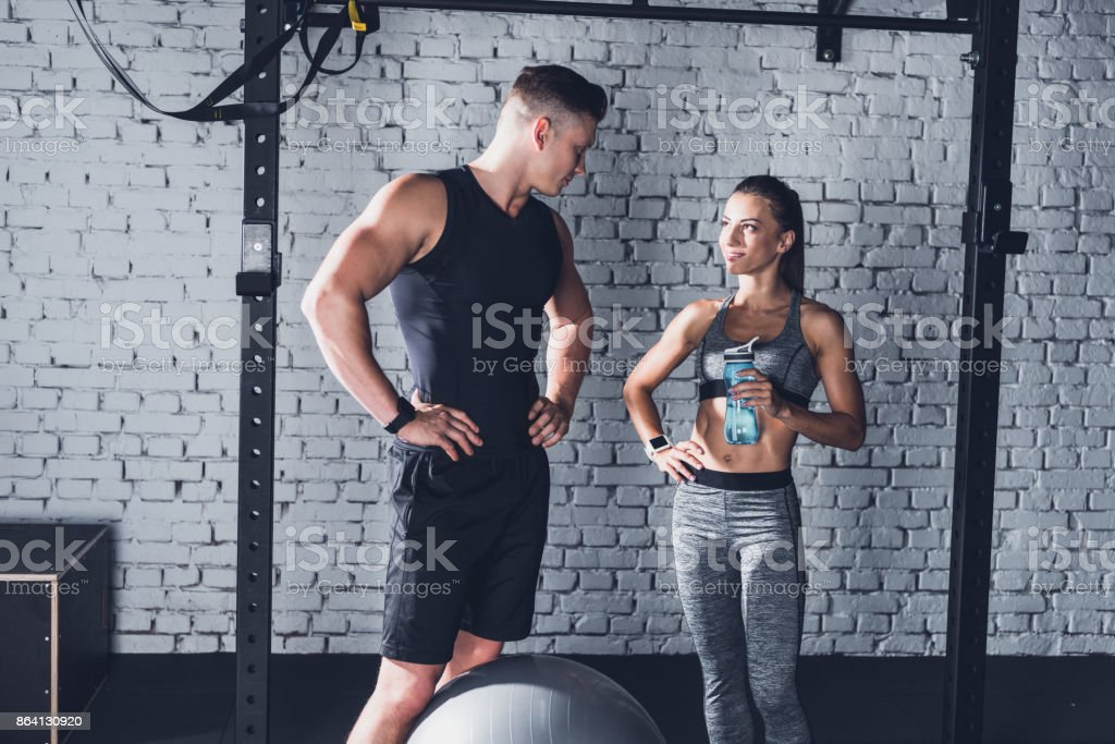 woman with sportive water bottle and boyfriend royalty-free stock photo