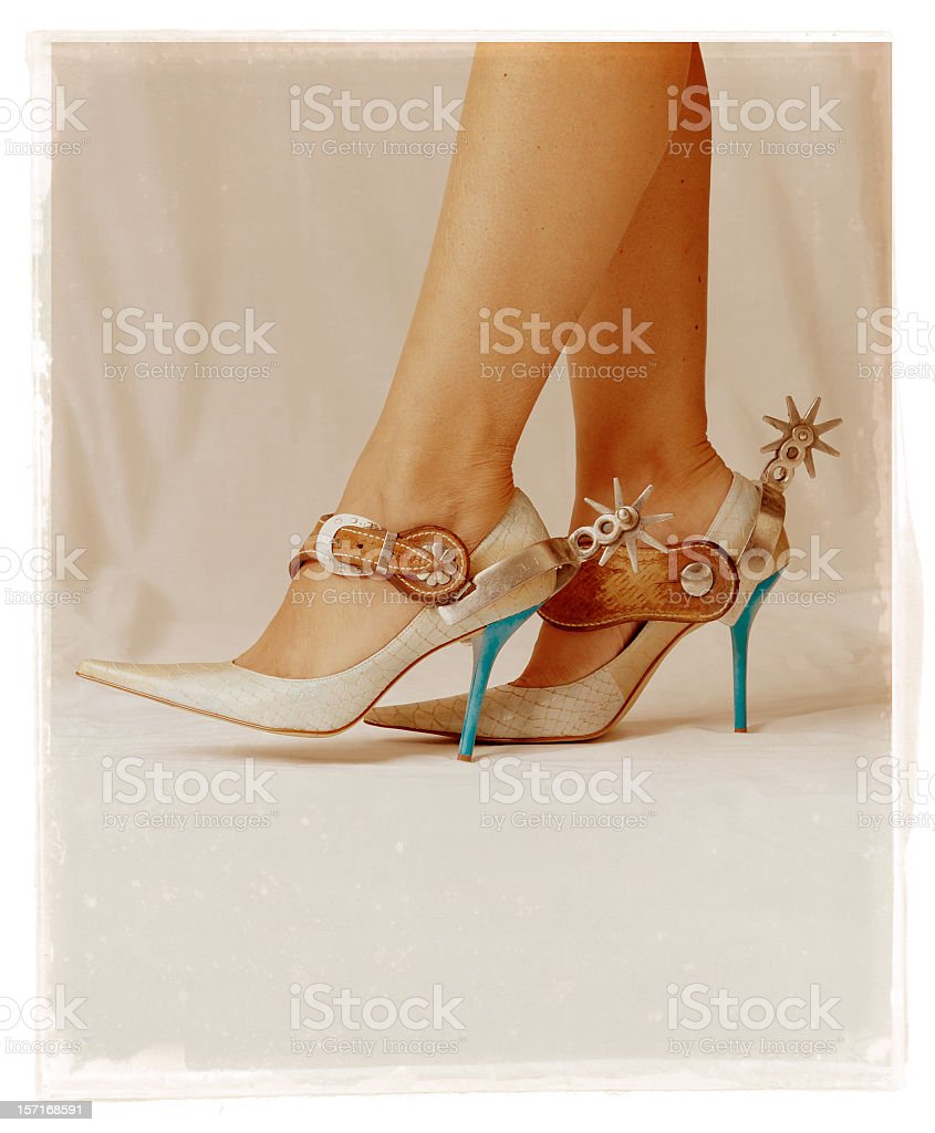 woman with spurs royalty-free stock photo