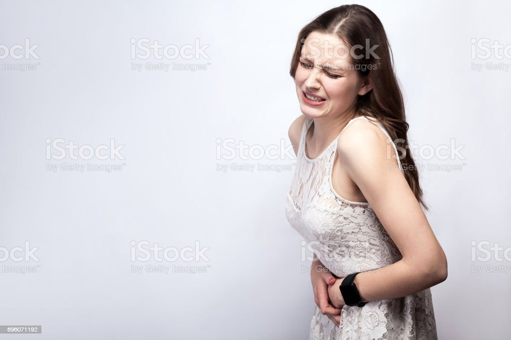 woman with stomach pain stock photo