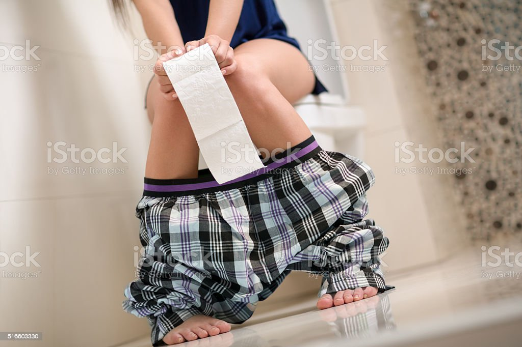 Woman with stomach problems stock photo