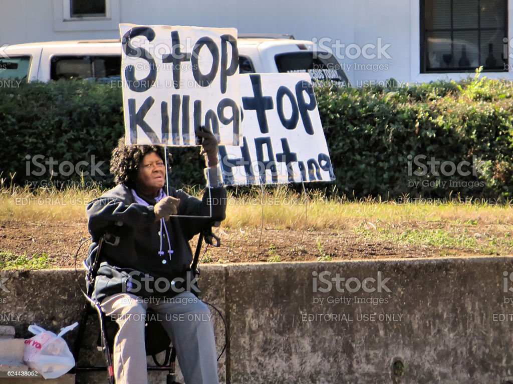 Woman With Stop Killing Sign stock photo