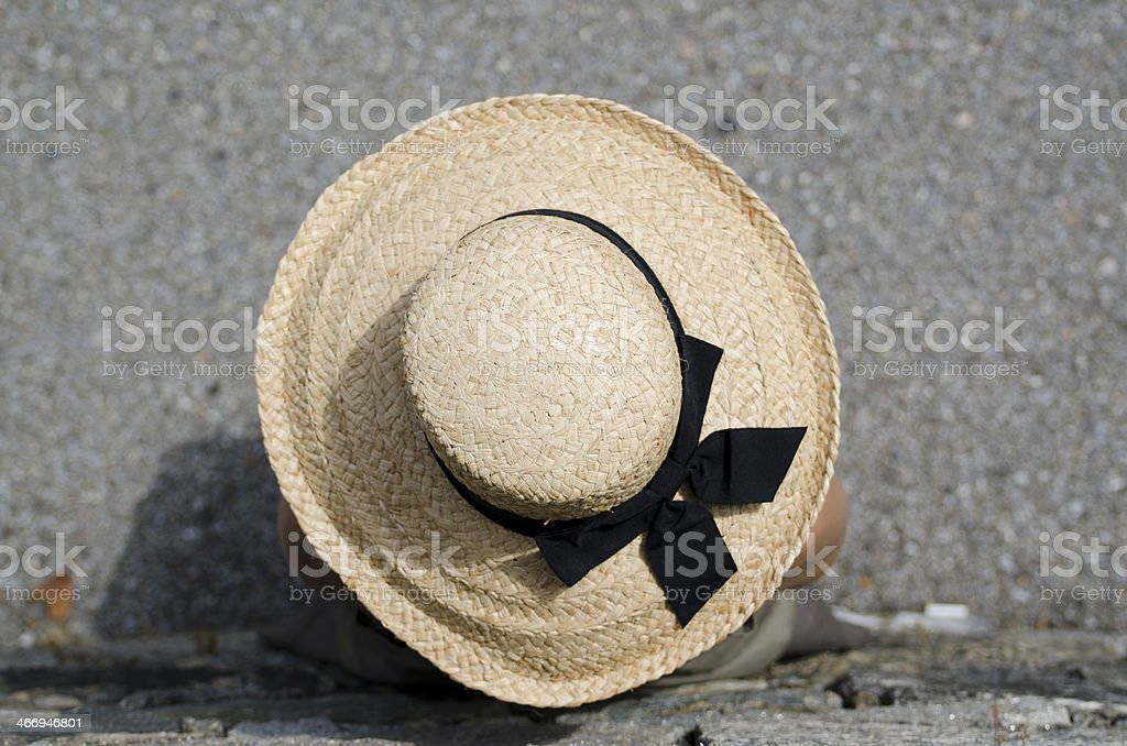 Woman with straw hat stock photo