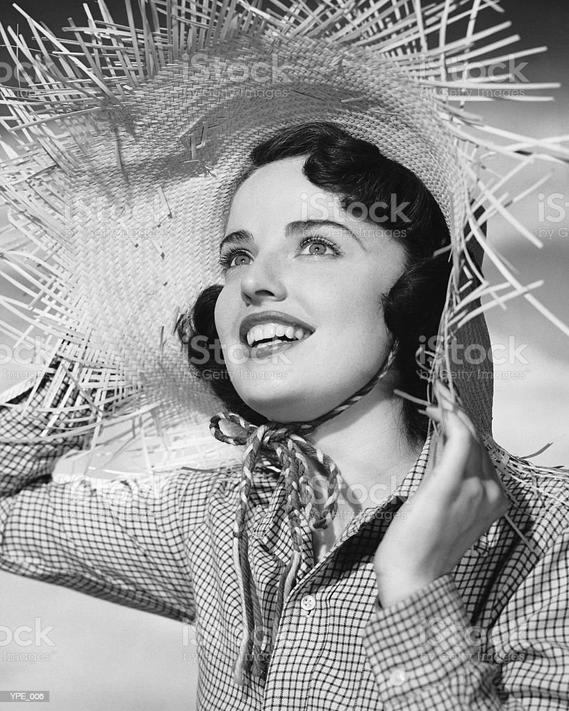 Woman with straw hat royalty free stockfoto