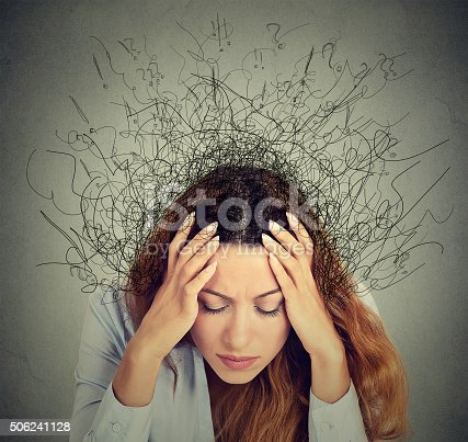 istock woman with stressed face expression brain melting into lines 506241128
