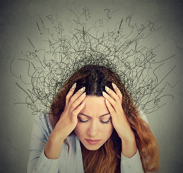 woman with stressed face expression brain melting into lines stock photo
