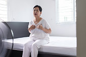 istock Woman with strong chest pain and hands touching her chest,Elderly female with heart attack symptom 1067276330