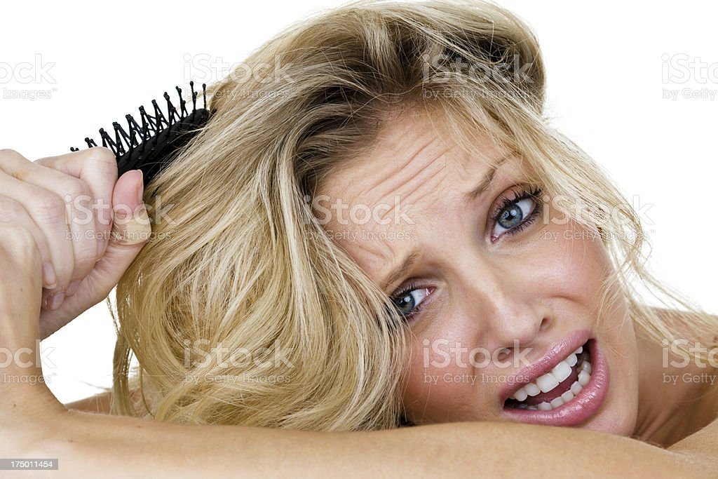 Woman with stuck hair brush royalty-free stock photo