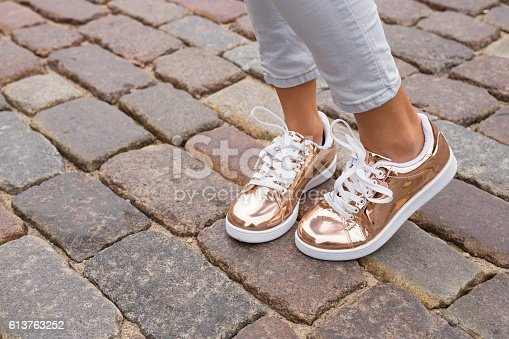istock Woman with stylish shoes in the city 613763252